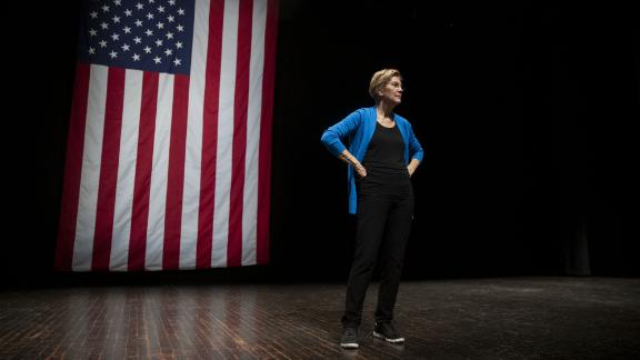 Senator Elizabeth Warren, a Democrat from Massachusetts and 2020 presidential candidate, stands on stage during a campaign event at Iowa State University in Ames, Iowa, U.S., on Monday, Oct. 21, 2019. Warren unveiled an $800 billion plan to fund her progressive proposal for reshaping U.S. public education and disclosed that her signature wealth tax will pay for school and child-care initiatives -- in effect transferring the cost of raising a child from birth to college to America's richest families. Photographer: Daniel Acker/Bloomberg/Getty Images