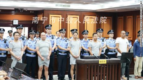 The six men were charged with intentional homicide after staging and outsourcing a murder plot in China's southern Guangxi province.