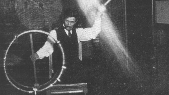 Nikola Tesla demonstrates an experiment  in his New York City lab in 1895.