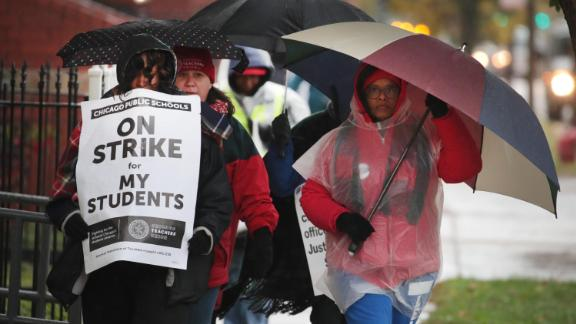 Striking Chicago teachers and their supporters picket outside of Oscar DePriest Elementary School on October 22, 2019 in Chicago, Illinois.