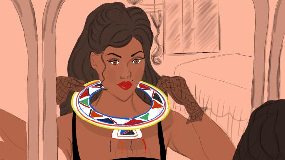 Maasai necklace: A woman adorned in handmade traditional jewelry from the Maasai tribe.