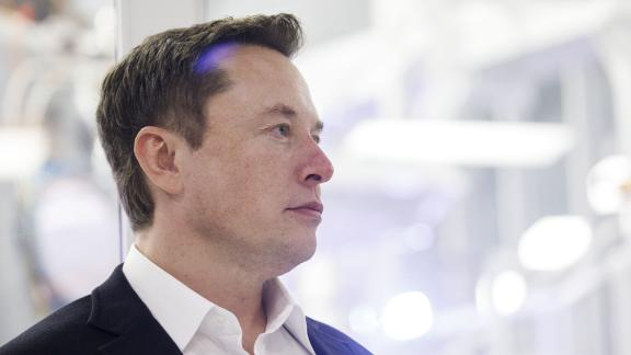 Elon Musk, chief executive officer of Space Exploration Technologies Corp. (SpaceX) and Tesla Inc., listens as Jim Bridenstine, administrator of the U.S. National Aeronautics and Space Administration (NASA), not pictured, speaks during an event at SpaceX headquarters in Hawthorne, California, U.S., on Thursday, Oct. 10, 2019. SpaceXsElon Muskand NASA AdministratorJim Bridenstine staged a public show of support for one another at the rocket companys headquarters Thursday, weeks after the two traded barbs over the closely held companys delayed efforts to fly astronauts for the first time. Photographer: Patrick T. Fallon/Bloomberg via Getty Images