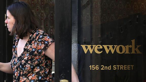 A woman walks out of a WeWork office on October 07, 2019 in San Francisco, California. Days after withdrawing its registration for an initial public offering.