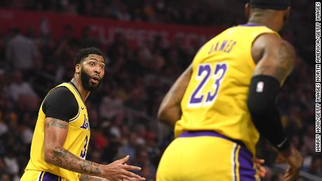 Newly aquired  Anthony Davis (left) of the Los Angeles Lakers interacted with teammate LeBron James during the first half of the game.