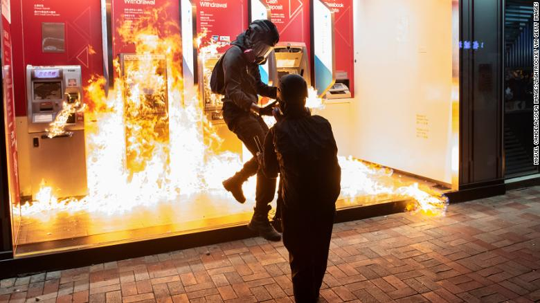 Protesters set a Bank of China branch on fire in Hong Kong on October 13, 2019.