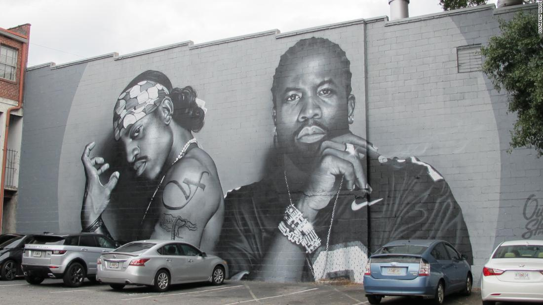 A mural of OutKast in Atlanta's Little Five Points neighborhood has attracted crowds of people coming to see the iconic duo.
