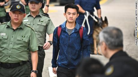 Chan Tong-kai, 20, wanted in Taiwan for the murder of his pregnant girlfriend during a holiday the two Hong Kongers took there in 2018, walks out the Pik Uk Prison in Hong Kong on October 23, 2019, after serving a short jail sentence for stealing his girlfriend's possessions. - Chan's case, where he fled back to Hong Kong where Taiwanese police were unable to apprehend him because there is no extradition agreement between the two territories, triggered an ill-fated proposal by Hong Kong's pro-Beijing government to ram through a sweeping extradition bill, which would have allowed the city to extradite suspects to any territory including the authoritarian mainland. (Photo by Philip FONG / AFP) (Photo by PHILIP FONG/AFP via Getty Images)