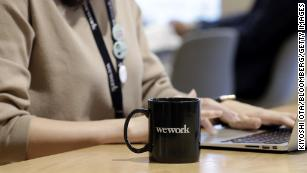 WeWork's disgraced CEO is getting a massive payout. Now workers await their own fate