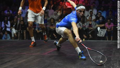 Ali Farag reaches for the ball during the men's final match of the PSA Dubai World Series Finals in 2018.