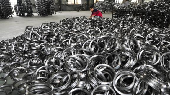 HANGZHOU, CHINA - SEPTEMBER 02: A worker inspects baby stroller steel rims for exporting to America at a workshop in Tianmushan town on September 2, 2019 in Hangzhou, Zhejiang Province of China. (Photo by VCG/VCG via Getty Images)