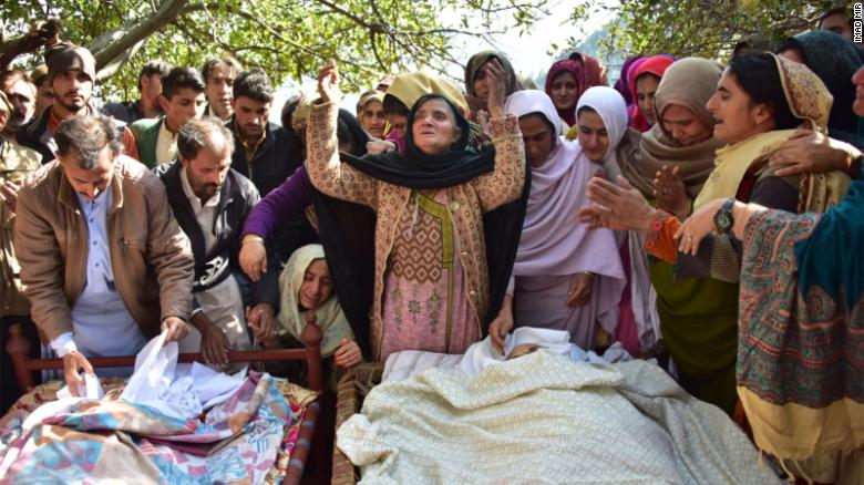Relatives mourn next to bodies of victims in cross border shelling in Nousehri, a village in Neelum Valley on October 20, 2019.