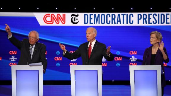 WESTERVILLE, OHIO - OCTOBER 15: (L-R) Sen. Bernie Sanders (I-VT), former Vice President Joe Biden, and Sen. Elizabeth Warren (D-MA) react during the Democratic Presidential Debate at Otterbein University on October 15, 2019 in Westerville, Ohio. A record 12 presidential hopefuls are participating in the debate hosted by CNN and The New York Times. (Photo by Win McNamee/Getty Images)