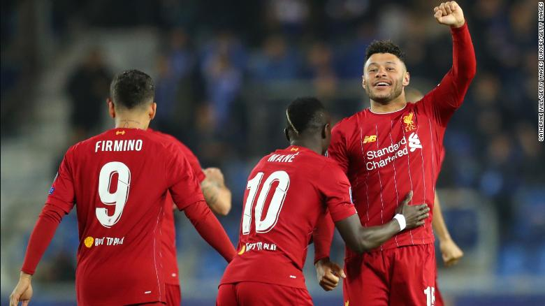 Alex Oxlade-Chamberlain of Liverpool celebrates with teammate Sadio Mane after scoring his team's first goal.