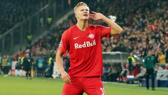 Erling Braut Håland celebrates after scoring against Napoli in the Champions League.