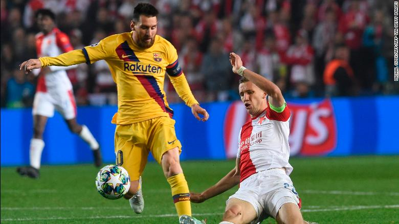 Slavia Prague's midfielder Tomas Soucek (R) vies for the ball with Barcelona's striker Lionel Messi during the Champions League clash.