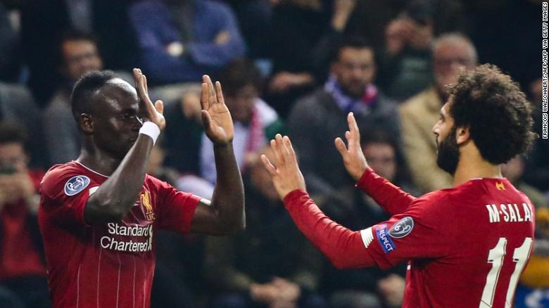 Liverpool's Sadio Mane (L) celebrates with teammate Mohamed Salah (R) after scoring.