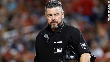 MLB umpire Rob Drake tweeted Tuesday he would buy an AR-15 rifle because of the impeachment inquiry, according to a copy of the tweet obtained by ESPN.