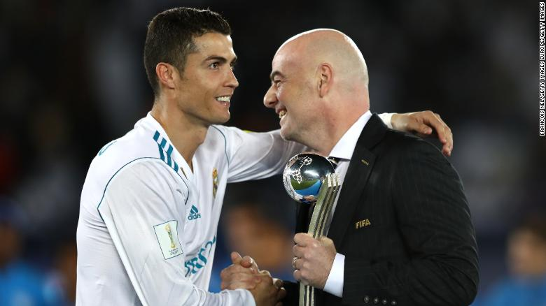 Cristiano Ronaldo collects the Silver Ball trophy from Gianni Infantino after winning the 2017 Club World Cup with Real Madrid.