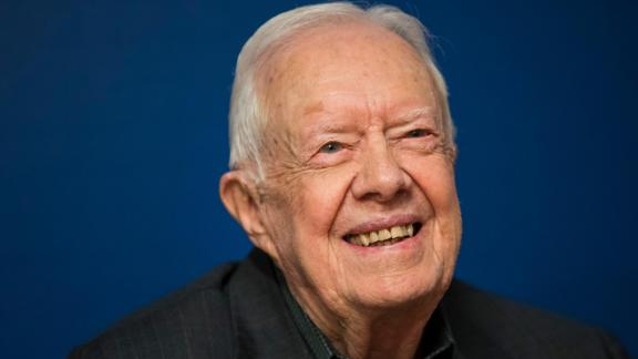 Former US President Jimmy Carter smiles during a book signing event, March 2018, in New York City.