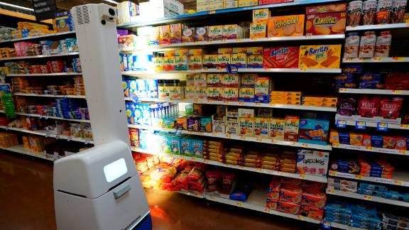 """The """"Auto-S,"""" Walmart's shelf-scanning robot, moves around aisles and identifies which items are low or out of stock."""
