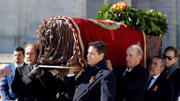 Family members Jose Cristobal (L) and Prince Louis Alphonse of Bourbon, Duke of Anjou (R), Francis Franco (3rdR) and Jaime Martinez-Bordiu (2ndR) carry the coffin of Spanish dictator Francisco Franco out of the basilica.