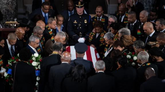 Members of the Congressional Black Caucus gather around the casket during a memorial service for U.S. Rep. Elijah Cummings (D-MD) in the Statuary Hall of the U.S. Capitol October 24.