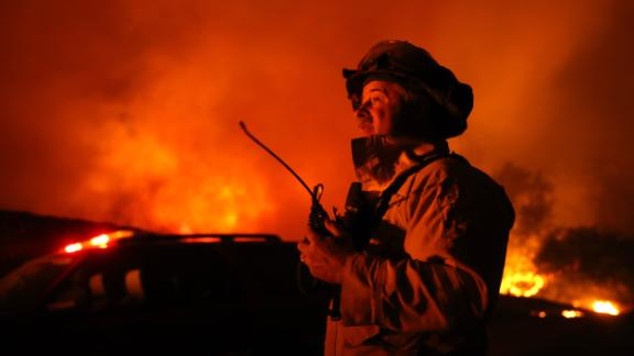 A firefighter monitors the Kincade Fire in Geyserville on October 24.