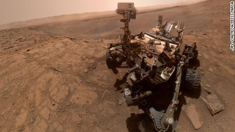 Curiosity rover snapping new selfie while conducting a chemistry experiment