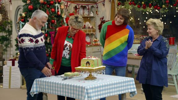 """""""The Great British Baking Show: Holidays"""" Season 2: Twinkling eyes? White beard? Santa has nothing on Paul Hollywood as he and Prue Leith judge festive treats baked by some favorite former competitors. (Netflix)"""