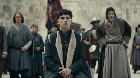 """""""The King"""": Hal (Timothée Chalamet), wayward prince and reluctant heir to the English throne, has turned his back on royal life and is living among the people. But when his tyrannical father dies, Hal is crowned King Henry V and is forced to embrace the life he had previously tried to escape. (Netflix)"""