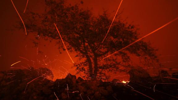 Embers blow in the wind as the Kincaide Fire burns in Geyserville, California.