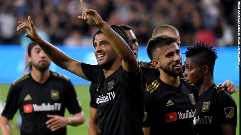 Carlos Vela (center) of LAFC celebrates his second goal against the LA Galaxy on Thursday in Los Angeles. The team's victory in the MLS Cup Playoffs was its first win against its inter-city rivals in six tries.