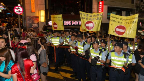 Hong Kong Police officers standing guard in Lan Kwai Fong in 2013.