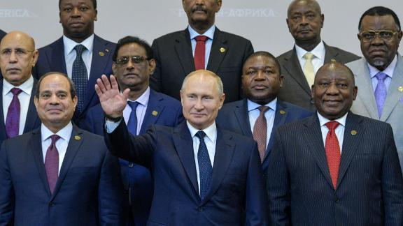 Russian President Vladimir Putin (C) gestures as Egypt's President Abdel Fattah al-Sisi (L) and South African President Cyril Ramaphosa (R) pose for a family photo with African countries leaders attending 2019 Russia-Africa Summit and Economic Forum in Sochi on October 24, 2019. (Photo by Alexei Druzhinin / SPUTNIK / AFP) (Photo by ALEXEI DRUZHININ/SPUTNIK/AFP via Getty Images)
