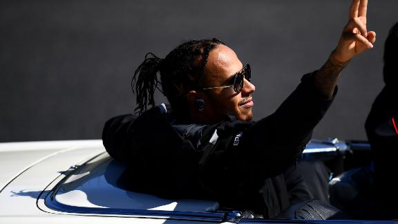 Hamilton waves to the crowd before the Japanese Grand Prix.