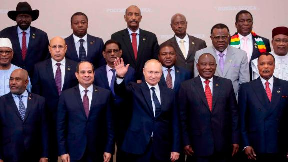 Russian President Vladimir Putin (C) gestures as Egypt's President Abdel Fattah al-Sisi (1st row, 2L) and South African President Cyril Ramaphosa (2R) pose for a family photo with African countries leaders attending 2019 Russia-Africa Summit and Economic Forum in Sochi, on October 24, 2019. (Photo by Sergei CHIRIKOV / POOL / AFP) (Photo by SERGEI CHIRIKOV/POOL/AFP via Getty Images)