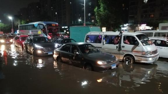 Cars drive on a flooded street following rainfall that led to traffic jam in the Heliopolis district in the Egyptian capital Cairo on October 22, 2019.