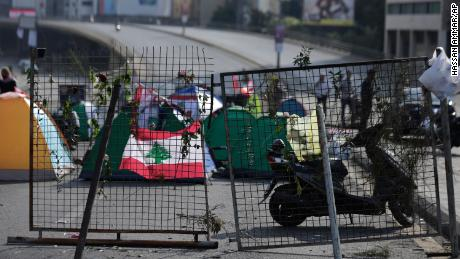 Anti-government protesters block the main highway linking east and west Beirut with tents, stones and bricks on Friday.