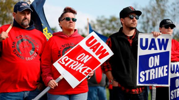 United Auto Workers union member and their families rally near the General Motors Flint Assembly plant on October 13, 2019 in Flint, Michigan.