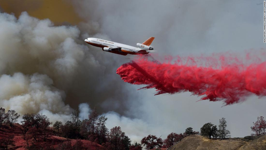 A firefighting aircraft intervenes over Sonoma County, California, where the Kincade Fire was burning on October 25.