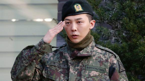 G-Dragon poses for photographs after being discharged from the army in Yongin, South Korea, on October 26, 2019.
