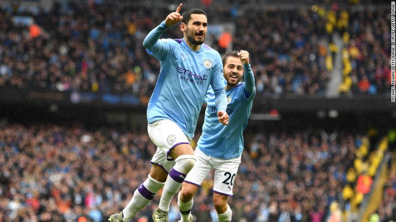 Ilkay Gundogan of Manchester City celebrates after scoring his team's final goal in the 3-0 Premier League win over Aston Villa.
