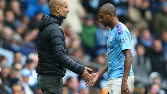 Manchester City manager Pep Guardiola watches on as Fernandinho leaves the pitch after his late red card in the win over Aston Villa.