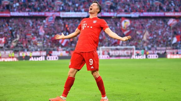 Robert Lewandowski celebrates his goal for Bayern Munich in the 2-1 win over Union Berlin to set a new Bundesliga record of scoring in nine straight league games.