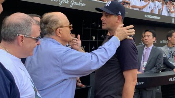Rudy Giuliani (center) speaks with New York Yankees manager Aaron Boone prior to a game between the Yankees and the Boston Red Sox in London in June 2019.  Lev Parnas, a now-indicted associate of Giuliani