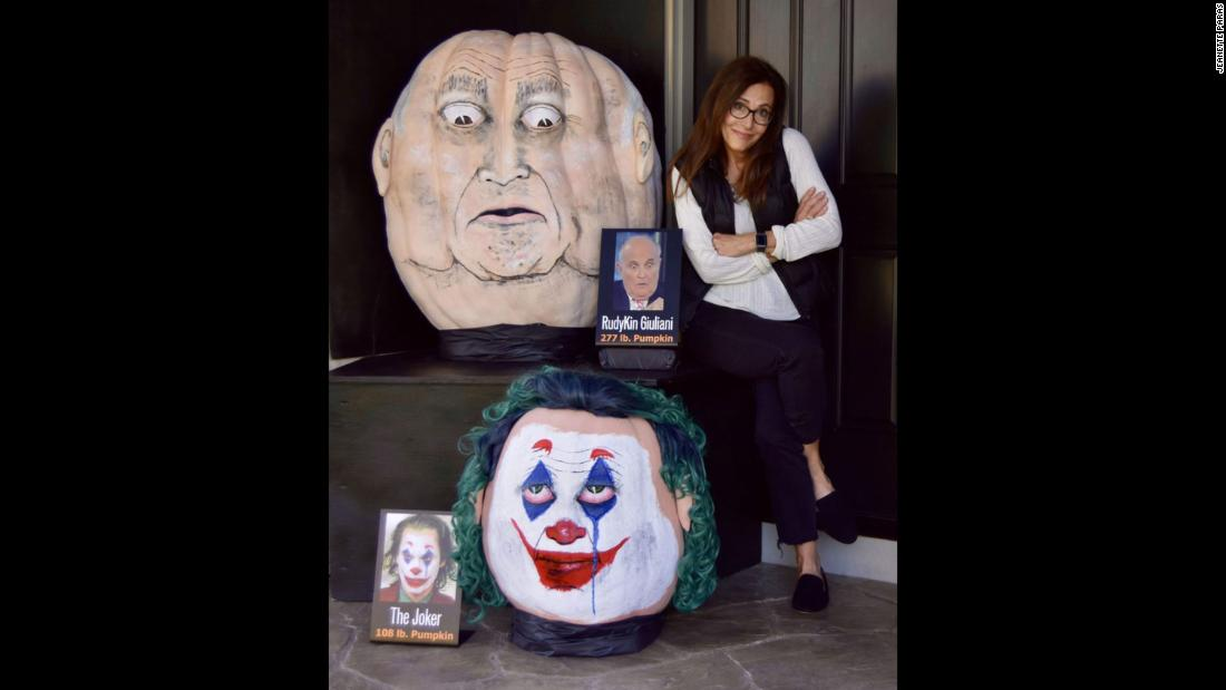 "Each year, Jeanette Paras selects a person in the news or pop culture and paints a giant pumpkin caricature. ""Well this year Rudy Giuliani has been in the news a lot lately and he certainly is monopolizing the news,"" the pumpkin creator said."