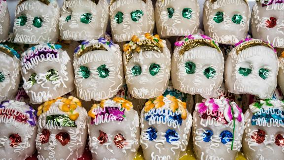 Skulls made and decorated with sugar decorate altars and are given as gifts for Día de los Muertos.