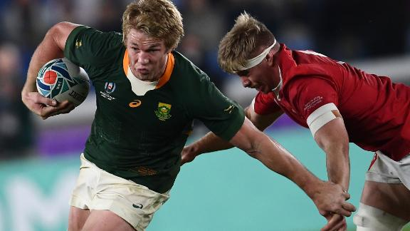 Wales takes on South Africa in the second semifinal in Yokohama Sunday. Welshman Aaron Wainwright (right) tackles Springbok flanker Pieter-Steph Du Toit.