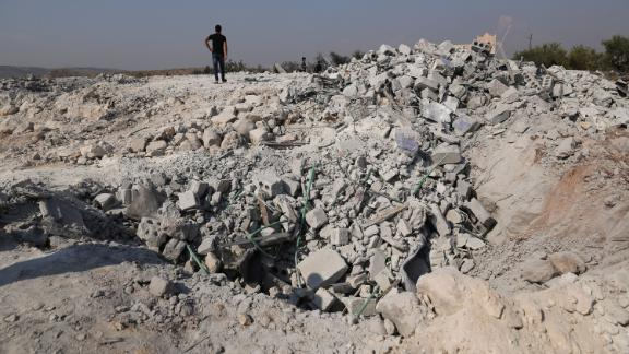 People look at a destroyed houses near the village of Barisha, in Idlib province, Syria, Sunday, Oct. 27, 2019, after an operation by the U.S. military which targeted Abu Bakr al-Baghdadi, the shadowy leader of the Islamic State group. President Donald Trump says Abu Bakr al-Baghdadi is dead after a U.S. military operation in Syria targeted the Islamic State group leader. (AP Photo/Ghaith Alsayed)