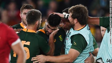 South African players celebrate Damian de Allende's try.